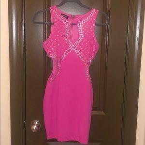 Pink curve hugging bebe dress
